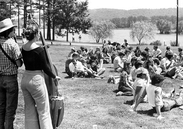 Vintage photo of students on quad listening to live band